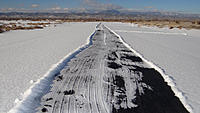 Name: plowed runway.jpg Views: 81 Size: 184.3 KB Description: The runway is plowed. It all melted by noon.