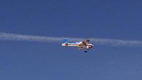 Name: DSC04010.jpg Views: 44 Size: 119.0 KB Description: Art's red/white/blue Yak flies down a contrail.