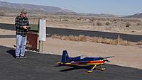 Name: DSC04442.jpg Views: 52 Size: 196.0 KB Description: Ross readies his own Great Planes Edge for flight.