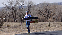 Name: DSC04585.jpg Views: 52 Size: 141.1 KB Description: Russ helps Marty bring his plane into the pits.