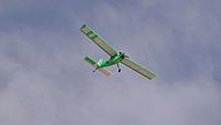 Name: DSC05828.jpg Views: 48 Size: 129.4 KB Description: Rob gets the Telemaster airborne.