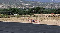 Name: DSC05929.jpg Views: 39 Size: 156.0 KB Description: Ross brings the biplane down for a soft landing.