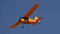 Name: DSC06082.jpg Views: 41 Size: 194.6 KB Description: Orval brings the Parkzone Cub past the pits for a photo fly-by.