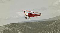 Name: DSC06489.jpg Views: 45 Size: 111.0 KB Description: The little Dreidecker makes a pass over the mountains.
