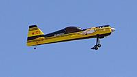 Name: DSC06568.jpg Views: 48 Size: 90.4 KB Description: Art brings the yellow and black Sukhoi past the pilot stations.