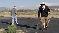 Name: DSC07884.jpg Views: 44 Size: 275.5 KB Description: Pat (left) retrieves the round foamie while Daren walks back to the pits.