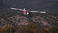 Name: DSC08638.jpg Views: 46 Size: 221.8 KB Description: The trainer settles in for a landing.
