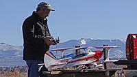 Name: DSC09695.jpg Views: 44 Size: 213.6 KB Description: Ross warms up his 20cc biplane.