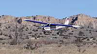 Name: DSC09723.jpg Views: 52 Size: 248.9 KB Description: Tom's high-winger settles down on the runway.
