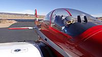 Name: DSC00706.jpg Views: 39 Size: 197.1 KB Description: The pilot doing his post flight checks.