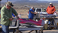 Name: DSC01081.jpg Views: 44 Size: 342.3 KB Description: From left, Pat, Tom and Gary prep for flight in the pits.