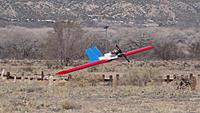 Name: DSC01507.jpg Views: 45 Size: 289.2 KB Description: Sans landing gear, Ross nails a perfect dead stick landing.