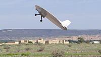 Name: DSC04264.jpg Views: 33 Size: 172.2 KB Description: Daren shows the crowd how to harrier a round plane.