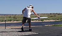 Name: DSC04752.jpg Views: 42 Size: 273.2 KB Description: Daren walks his Round-2-It to the flight line.