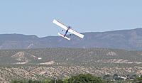 Name: DSC04655.jpg Views: 46 Size: 226.8 KB Description: Tom climbs out on take-off.