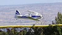 Name: DSC05433.jpg Views: 56 Size: 211.1 KB Description: Chris's crazy aerobatic Gemini stays level long enough for a photo.
