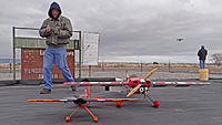 """Name: DSC07287.jpg Views: 40 Size: 144.2 KB Description: New club member Chris gets some photos of his 41"""" Edge next to my 74"""" Edge while Ross flies his multi-rotor on the flight line."""
