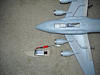How to install flight battery in nose of fuselage.   Step 1 secure to cardboard with Velcro.