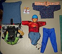 Showing all 3 shirts and both pants, along with storage bag for sail.