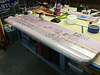 Name: IMG_3419.JPG Views: 21 Size: 2.31 MB Description: Fiber-reinforced tape was added to the wing to help add additional strength. I was pleasantly surprised to find out how stiff the wing panel was done when everything was complete.