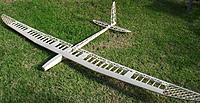 Name: StellarPete39.JPG Views: 21 Size: 817.2 KB Description: Here it is, sort of all together. Masking tape to hold all the bits in formation; the wing will not fit properly under the fuselage lip until the leading edge is shaped.