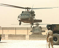 Name: 741px-CSA-2005-05-05-102937.jpg Views: 78 Size: 74.8 KB Description: UH-60s equipped with M60 machine guns near An Najaf, Iraq in May 2005.