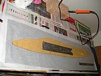 Name: DSC05330 (1024x768).jpg Views: 124 Size: 84.6 KB Description: Plastic rubbish bag sandwiched between 2 layers of baking paper. MDF template. 40W soldering iron. Brick*