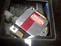Name: IMG-20110313-00034 (Large).jpg Views: 293 Size: 91.2 KB Description: Adapter on servo shaft, then coupler slides on that and uses pinch bolt to secure, similar to Ober stock setup.