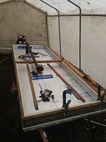 Insulation installed inside wooden frame using high temp silicone