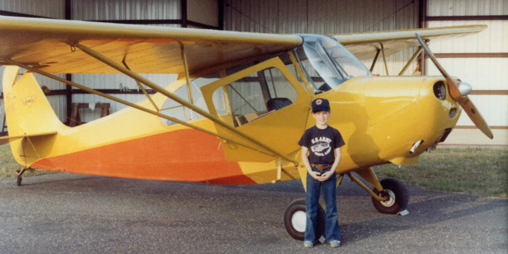 Name: AndyandChampWeb.jpg Views: 1,782 Size: 71.3 KB Description: A sharp-looking young man beside a good-looking airplane.  Me beside Dad's Champ in Enterprise, AL, ca. 1981.