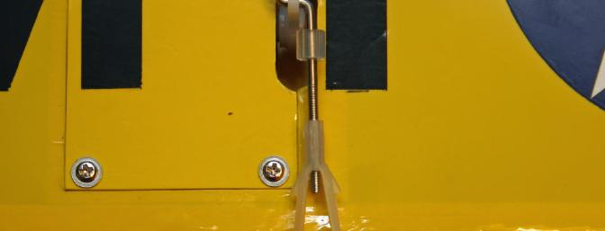 Clevis pin is directly over the hingeline to insure equal throws up and down.  Be sure to center the servo first!