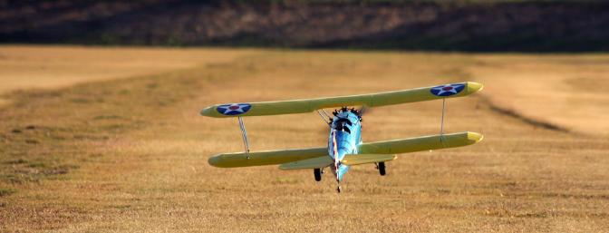 Here's the Stearman climbing out from a nice, scale takeoff from the grass.