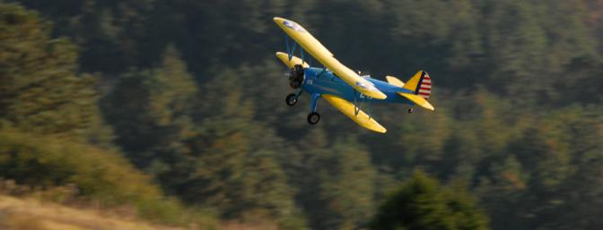 Nice shot of the Stearman zooming by.