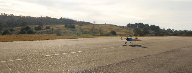 Nice wide-angle shot showing the Stearman setting down for a nice landing.