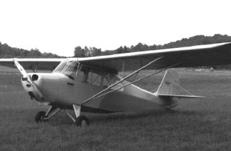 Old picture of a classic airplane, an Aeronca 7AC Champ.