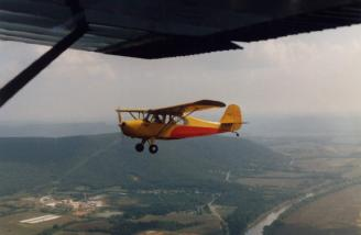 3439E cruising over the Tennessee River south of Huntsville, AL, ca. 1985.  Picture was taken by me from a friend's Cessna 120.