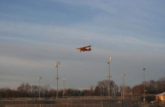 As I was flying, Gary turned around and snapped this picture of a real Champ on short final to the airport on the other side of the highway.  Not really, but it does look like it, doesn't it?