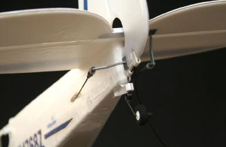 Note the plastic bushing on the tailwheel wire has been snapped into place.
