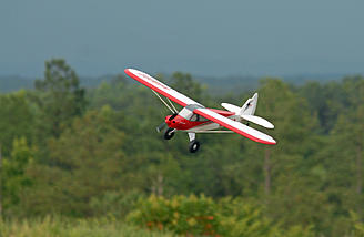 Sport Cub racked up in a good slip on final approach.