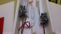 Name: 20150403_131102 - Copy.jpg Views: 236 Size: 602.8 KB Description: servos hot glued in.... then liberally coated with vaseline to  keep water out...