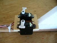 Name: Tuffy 2a.jpg Views: 1511 Size: 57.2 KB Description: I solved the pushrod problem by moving the servos to the rear but it sure doesn't help the balance situation.