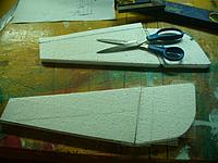 Name: GTF (10).jpg Views: 120 Size: 146.9 KB Description: Cover the top of each fin/ruddervator with drywall tape for strength and paint them at the same time after trimming the extra tape from the edges with a pairof sckisors.  I rounded the edges or the ruddervaotrs first, for looks..
