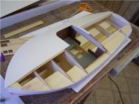 Name: CCH 24.jpg Views: 822 Size: 57.8 KB Description: The deck skin is applied in LH & RH halves. The fit was near perfect with just a bit of overhang to trim