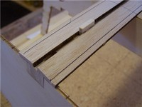 Name: Lym 20.jpg Views: 708 Size: 42.2 KB Description: The gauge block is used to draw a trim reference line on the outer edge of each plank.