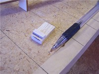 Name: Lym 23.jpg Views: 640 Size: 54.9 KB Description: A gauge block was made from scrap wood to insure the reference marks for trimming the plank edges was true and consistant.