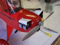 Name: J 38.jpg Views: 421 Size: 52.5 KB Description: Then the cowl was then aligned and mounted using the prop to align it properly