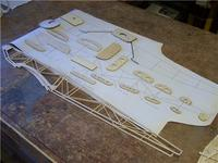 Name: Ag 19.jpg Views: 538 Size: 64.0 KB Description: then the rest of the fuselage formers were laid out.