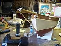 Name: TR 166.jpg Views: 110 Size: 66.6 KB Description: The Bowsprit was carved from spruce with fittings made from brass stock....