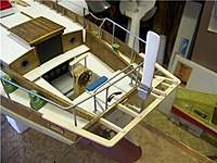 Name: TR 167.jpg Views: 115 Size: 66.1 KB Description: The stern platform and auto-rudder were fabricated from Bass and sheet styrene....