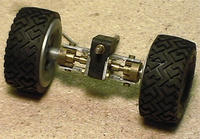 Name: 132axlesmall.jpg Views: 746 Size: 33.6 KB Description: Prototype steering front axle made from HO scale train gearbox.  This was the proff of concept for 1/24th scale axle in the following pictures..
